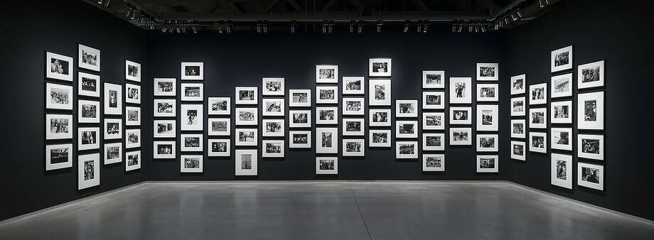 """Garry Winogrand installation, part of the exhibition """"The Grain of the Present,"""" at Pier 24 Photography through January. Photo: Pier 24 Photography"""