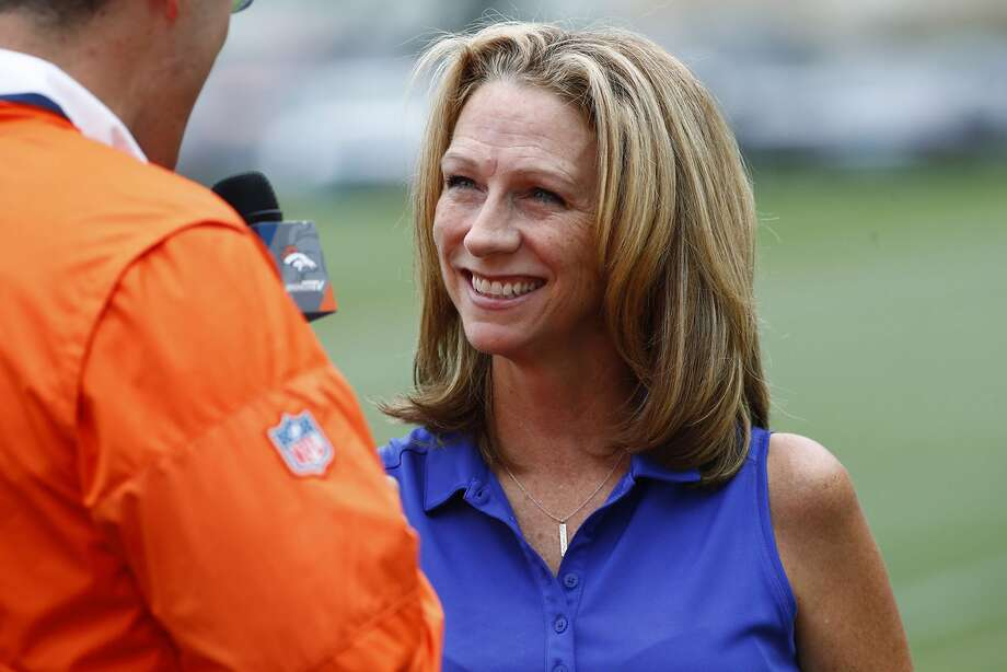 In this Saturday, July 29, 2017 photo, broadcaster Beth Mowins chats with a reporter while watching the Denver Broncos run through drills at NFL football training camp in Englewood, Colo. While Mowins is focused on football, she will become the first woman since 1987 to be the lead announcer on a nationally televised, regular season NFL game. (AP Photo/David Zalubowski) Photo: David Zalubowski, Associated Press