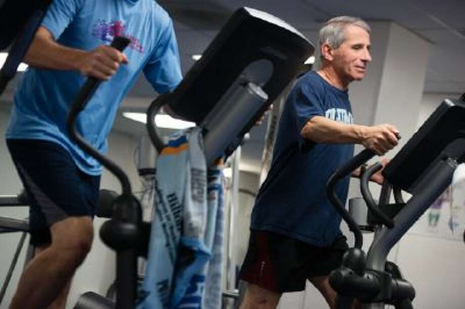 Dr. Anthony Fauci, 72, director of the National Institute of Allergy and Infectious Diseases, exercises Oct. 31, 2013 in the gym at the National Institutes of Health in Bethesda, Md.