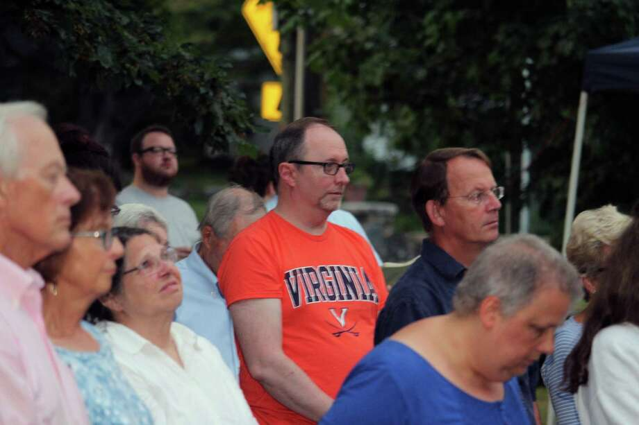 "Joseph Young, of Stamford, wears a University of Virginia shirt at a ""Service of Unity and Community"" at St. Luke's Parish in Darien, Conn., on Aug. 14 in response to the past weekend's terrorist attacks in Charlottesville, Va. Photo: Justin Papp / Hearst Connecticut Media / Darien News"