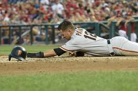 San Francisco Giants' Joe Panik reacts after he was tagged out at home during the fourth inning of the second baseball game of a split doubleheader against the Washington Nationals, Sunday, Aug. 13, 2017, in Washington. (AP Photo/Nick Wass)