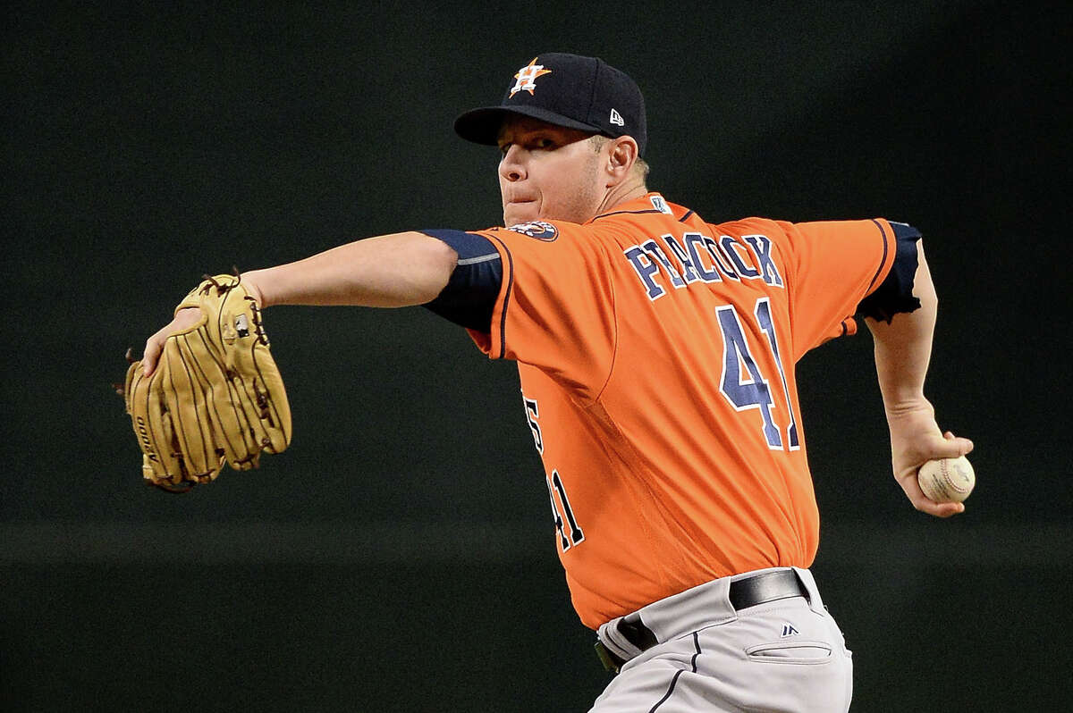 PHOENIX, AZ - AUGUST 15: Brad Peacock #41 of the Houston Astros throws a warm up pitch for the first inning of the MLB game against the Arizona Diamondbacks at Chase Field on August 15, 2017 in Phoenix, Arizona.