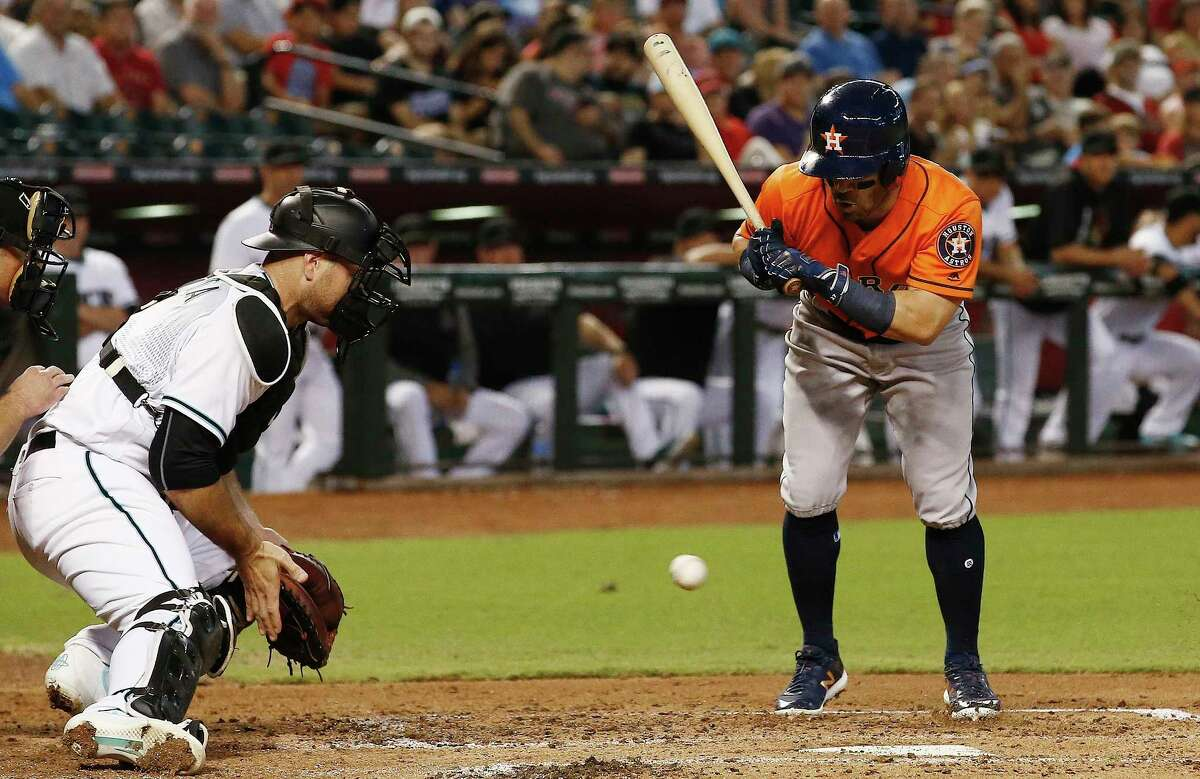 Arizona Diamondbacks' Chris Iannetta, left, tries to stop a wild pitch as Houston Astros' Jose Altuve, right, looks on during the second inning of a baseball game Tuesday, Aug. 15, 2017, in Phoenix. The Astros would score a run on the play. (AP Photo/Ross D. Franklin)