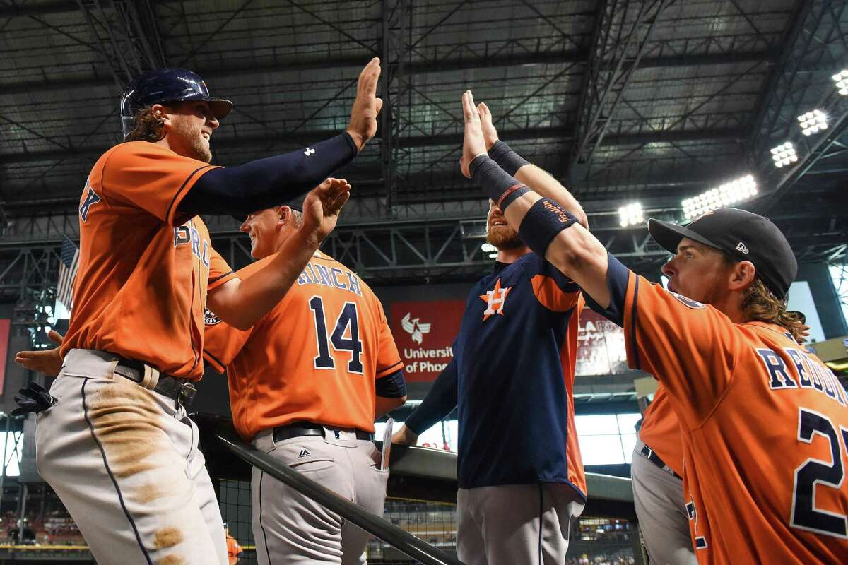 PHOENIX, AZ - AUGUST 15: Jake Marisnick #6 of the Houston Astros is congratulated by Josh Reddick #22 after scoring against the Arizona Diamondbacks in the third inning at Chase Field on August 15, 2017 in Phoenix, Arizona.