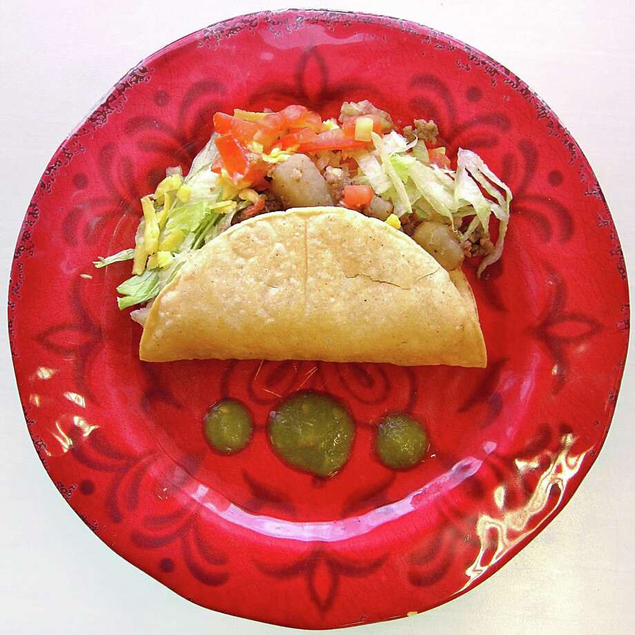 Crispy beef taco in a handmade corn shell from Josefina's Cafe. Photo: Mike Sutter /San Antonio Express-News