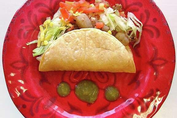 Crispy beef taco in a handmade corn shell from Josefina's Cafe.