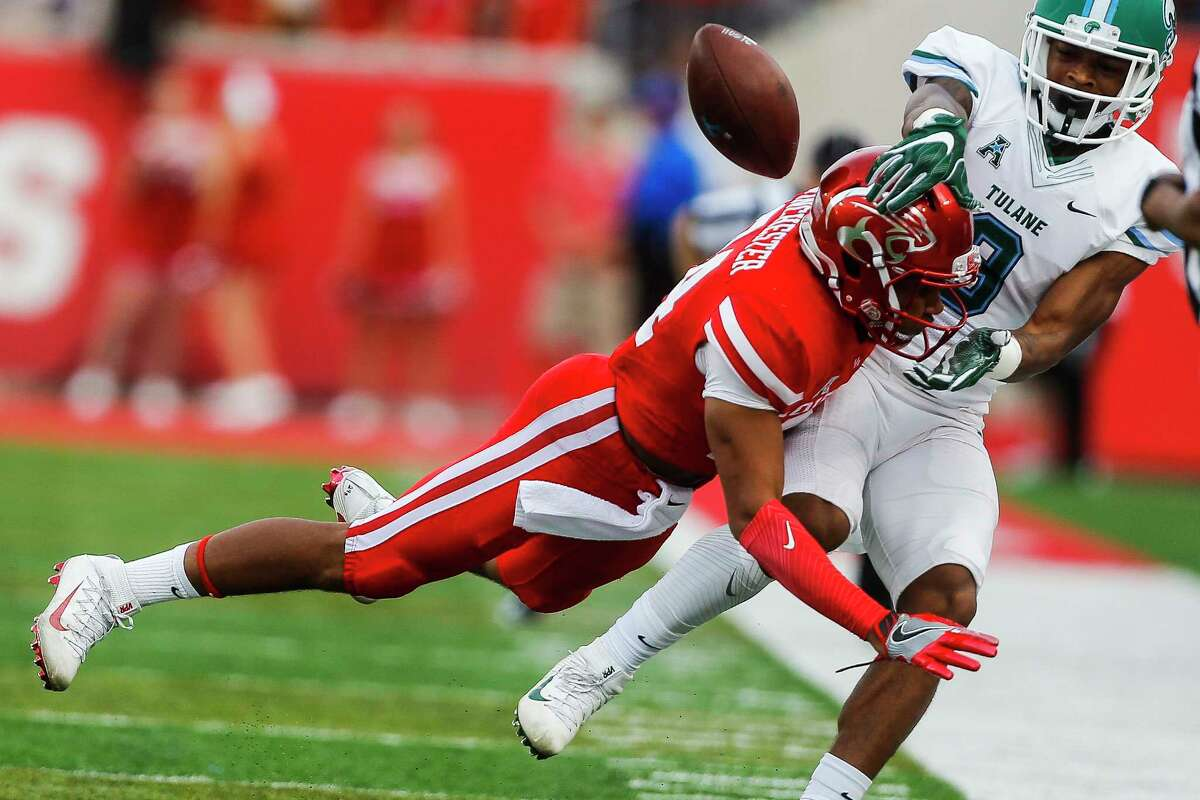 Houston Cougars cornerback Jeremy Winchester (24) breaks up a pass intended for Tulane Green Wave wide receiver Chris Johnson (9) with a hard hit as the Houston Cougars take on the Tulane Green Wave at TDECU Stadium Saturday, Nov. 12, 2016 in Houston. ( Michael Ciaglo / Houston Chronicle )