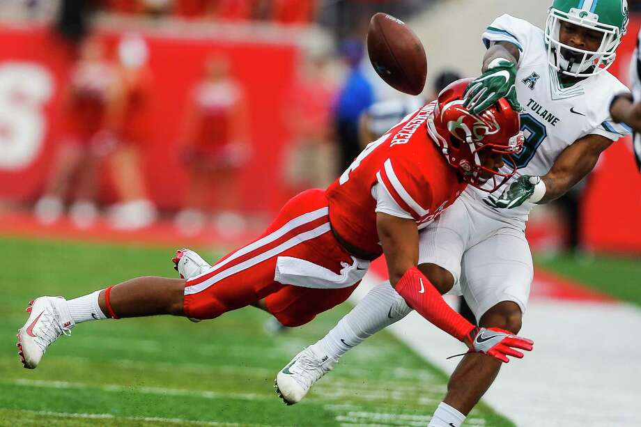 Houston Cougars cornerback Jeremy Winchester (24) breaks up a pass intended for Tulane Green Wave wide receiver Chris Johnson (9) with a hard hit as the Houston Cougars take on the Tulane Green Wave at TDECU Stadium Saturday, Nov. 12, 2016 in Houston. ( Michael Ciaglo / Houston Chronicle ) Photo: Michael Ciaglo, Staff / © 2016  Houston Chronicle