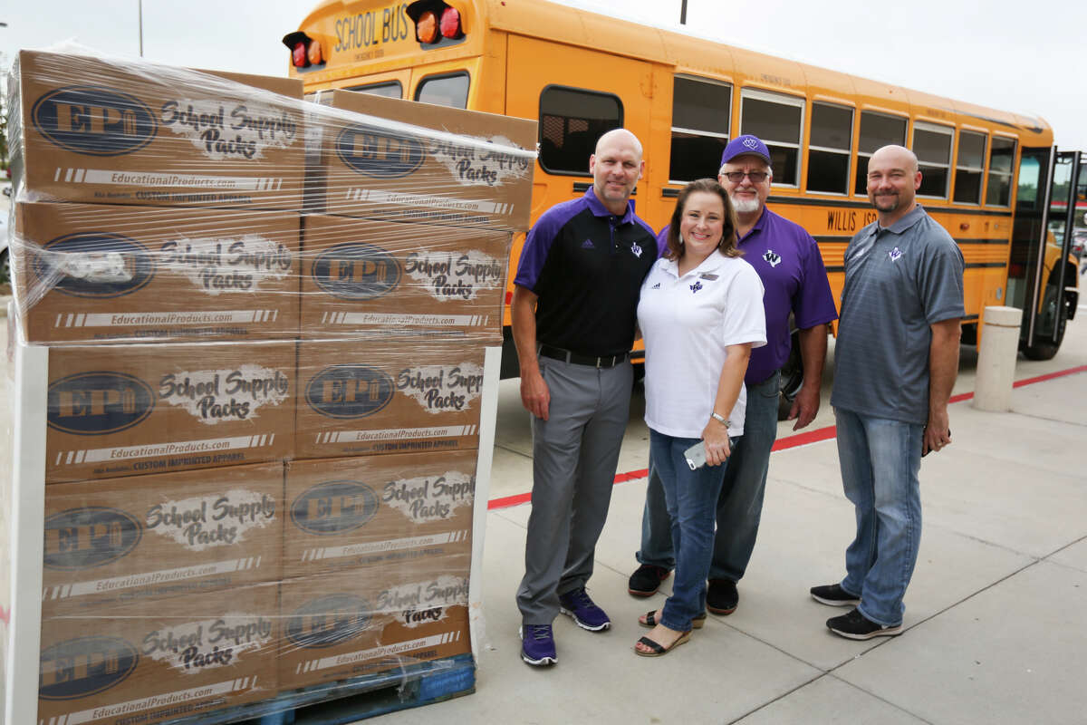 From the left: Willis ISD Superintendent Tim Harkrider, Director of Communications Jamie Fails, Kroger Store Manager Mike Medved, and Brian Greeney, WISD Assistant Superintendent of Innovation Teaching and Learning, pose for a photo next to donated school supplies outside of the Kroger Marketplace on Friday in Willis.