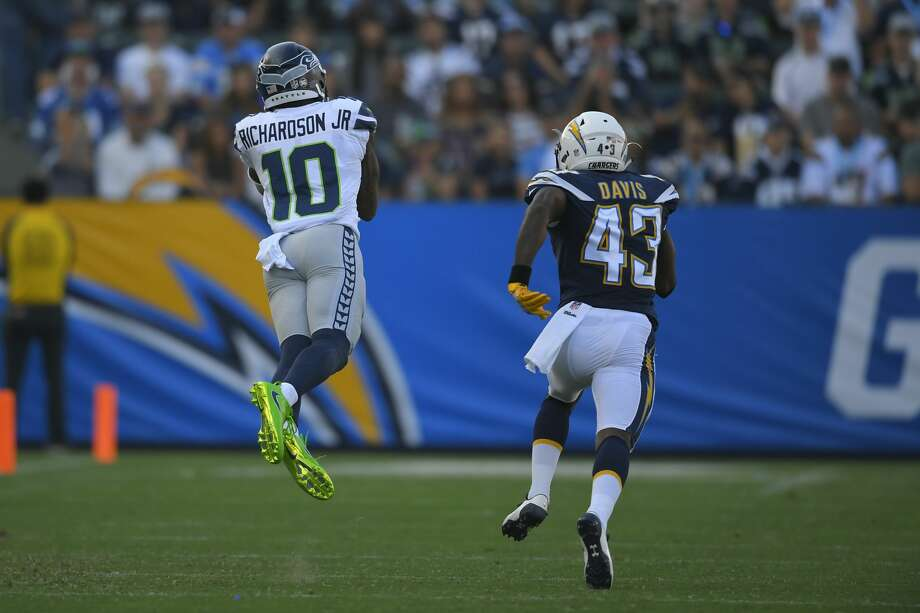 Seattle Seahawks wide receiver Jamel Johnson (10) makes a diving catch as Los Angeles Chargers cornerback Michael Davis (43) defends during the first half of an NFL football game Sunday, Aug. 13, 2017, in Carson, Calif. (AP Photo/Mark J. Terrill) Photo: Mark J. Terrill/AP