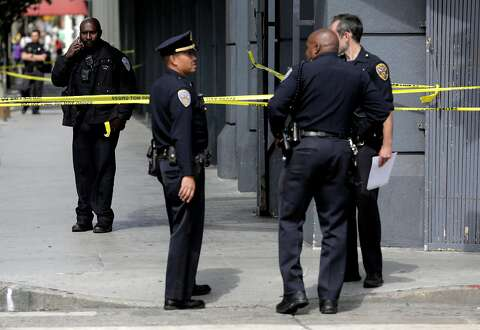 2d38b469a Police officers work the scene of a shooting at Burlington Coat Factory at  5th and Howard