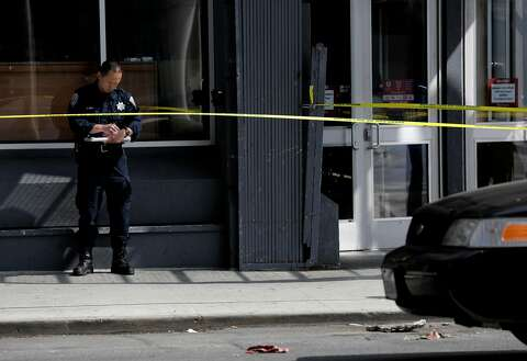 81e784cb2 An officer investigates the scene of a shooting at Burlington Coat Factory  at 5th and Howard