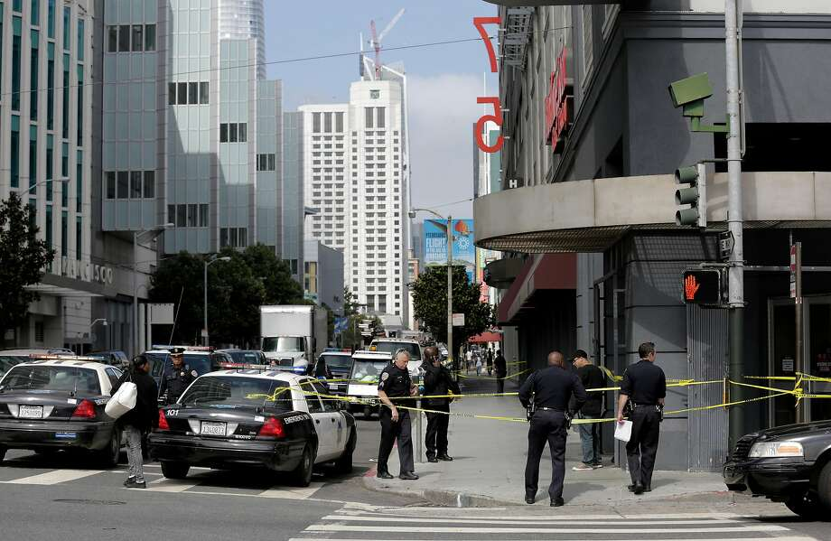 Police officers investigate the scene of a shooting at Burlington Coat Factory at 5th and Howard in San Francisco on Tuesday, August 15, 2017. Photo: Guy Wathen, The Chronicle