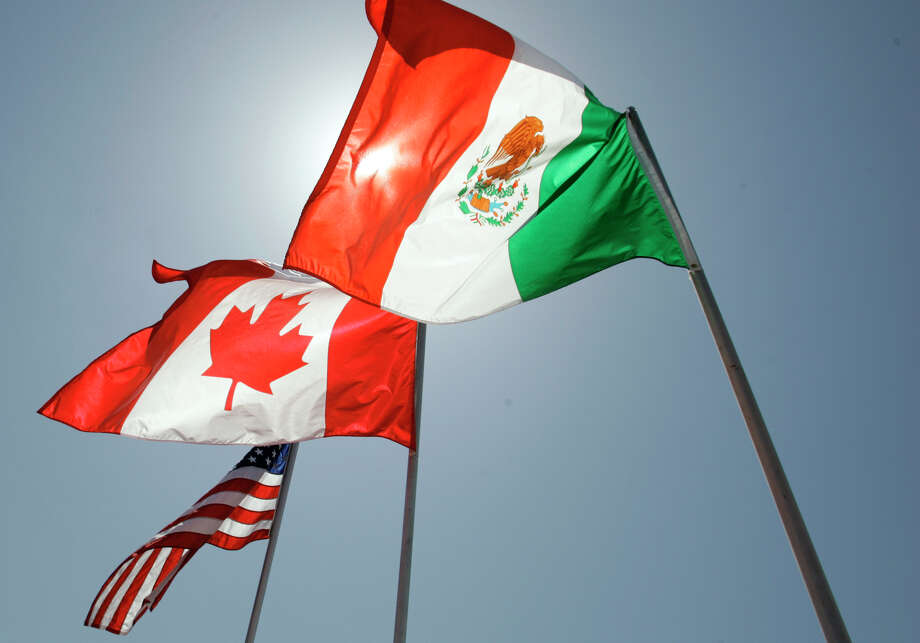 """""""Political systems haven't done what they needed to do to minimize the negative outcomes"""" of NAFTA, an economist says.  Photo: Judi Bottoni, STR / AP2008"""