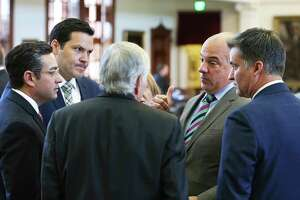 Rep. Chris Turner (second from right) talks with a group of lawmakers on the floor of the House just before the body of Legislators adjourned sine die on August 15, 2017.  From left are Rep. Cesar Blanco, D-El Paso, Rep. Justin Rodriguez, D-San Antonio, Rep. Tom Craddick, R-Midland, Turner, and Rep. Roland Gutierrez, D-San antoni.