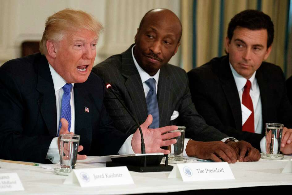 """FILE - In this Thursday, Feb. 23, 2017, file photo, President Donald Trump, left, speaks during a meeting with manufacturing executives at the White House in Washington, including Merck CEO Kenneth Frazier, center, and Ford CEO Mark Fields. Frazier is resigning from the President's American Manufacturing Council citing """"a responsibility to take a stand against intolerance and extremism."""" Frazier's resignation comes shortly after a violent confrontation between white supremacists and protesters in Charlottesville, Va. Trump is being criticized for not explicitly condemning the white nationalists who marched in Charlottesville. (AP Photo/Evan Vucci, File) ORG XMIT: NYBZ134"""