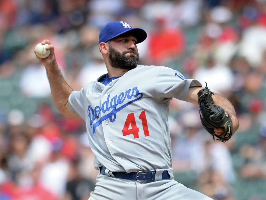 CLEVELAND, OH - JUNE 15, 2017: Pitcher Chris Hatcher #41 of the Los Angeles Dodgers throws a pitch in the seventh inning of a game on June 15, 2017 against the Cleveland Indians at Progressive Field in Cleveland, Ohio. Cleveland won 12-5. (Photo by: 2017 Nick Cammett/Diamond Images/Getty Images) Photo: Diamond Images / Diamond Images/Getty Images / 2017 DIAMOND IMAGES