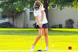 Edwardsville sophomore Jessica Benson hits her tee shot off the fourth hole of Tuesday's Madison County Tournament at the Legacy Golf Course in Granite City.