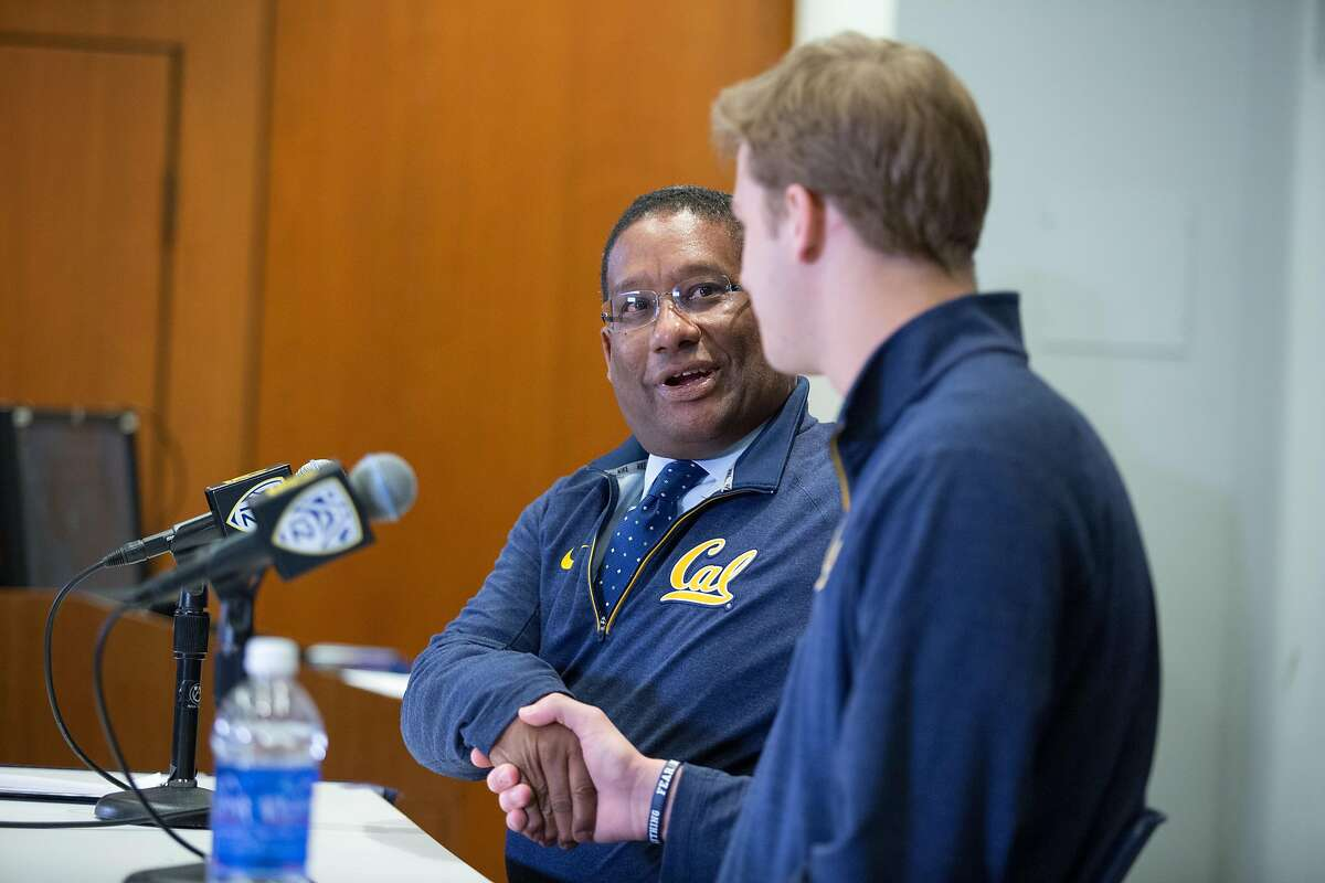 Cal athletic director Mike Williams, left, congratulates quarterback Jared Goff during a news conference at the Tahir Family Team Theatre near California Memorial Stadium, Thursday, Dec. 31, 2015, in Berkeley, Calif. Goff announced his plans to enter the upcoming NFL draft.