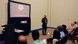 Texas A&M University admissions representative Eric Watson leads a large group informative session for CFISD students and parents during College Night earlier this month. Knowledge of earning potential in each major is crucial.