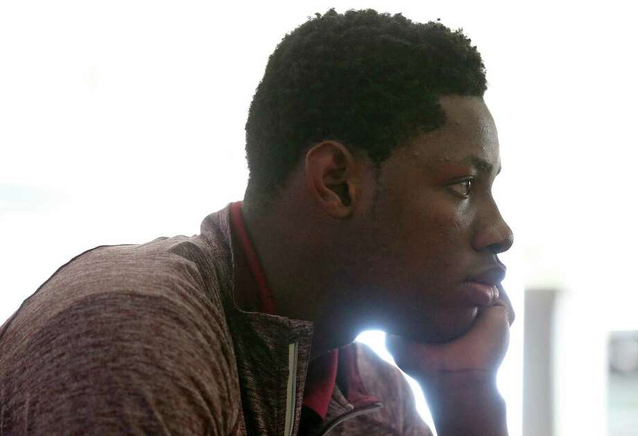 St. Anthony basketball player Charles Bassey watches a video during world history class at the school in February 2017. Photo: Edward A. Ornelas /San Antonio Express-News / © 2017 San Antonio Express-News