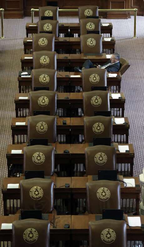 Texas Rep. Drew Springer, R-Gainsville, works at his desk as he waits for the House to convene, Tuesday, Aug. 15, 2017, in Austin. The special session will end Wednesday with the Texas 'bathroom bill' expected to fail. (AP Photo/Eric Gay) Photo: Eric Gay, STF / Associated Press / Copyright 2017 The Associated Press. All rights reserved.