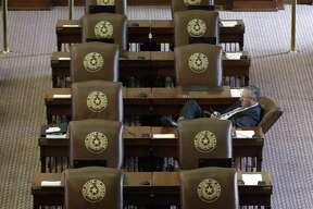 Texas Rep. Drew Springer, R-Gainsville, works at his desk as he waits for the House to convene, Tuesday, Aug. 15, 2017, in Austin. The special session will end Wednesday with the Texas 'bathroom bill' expected to fail. (AP Photo/Eric Gay)