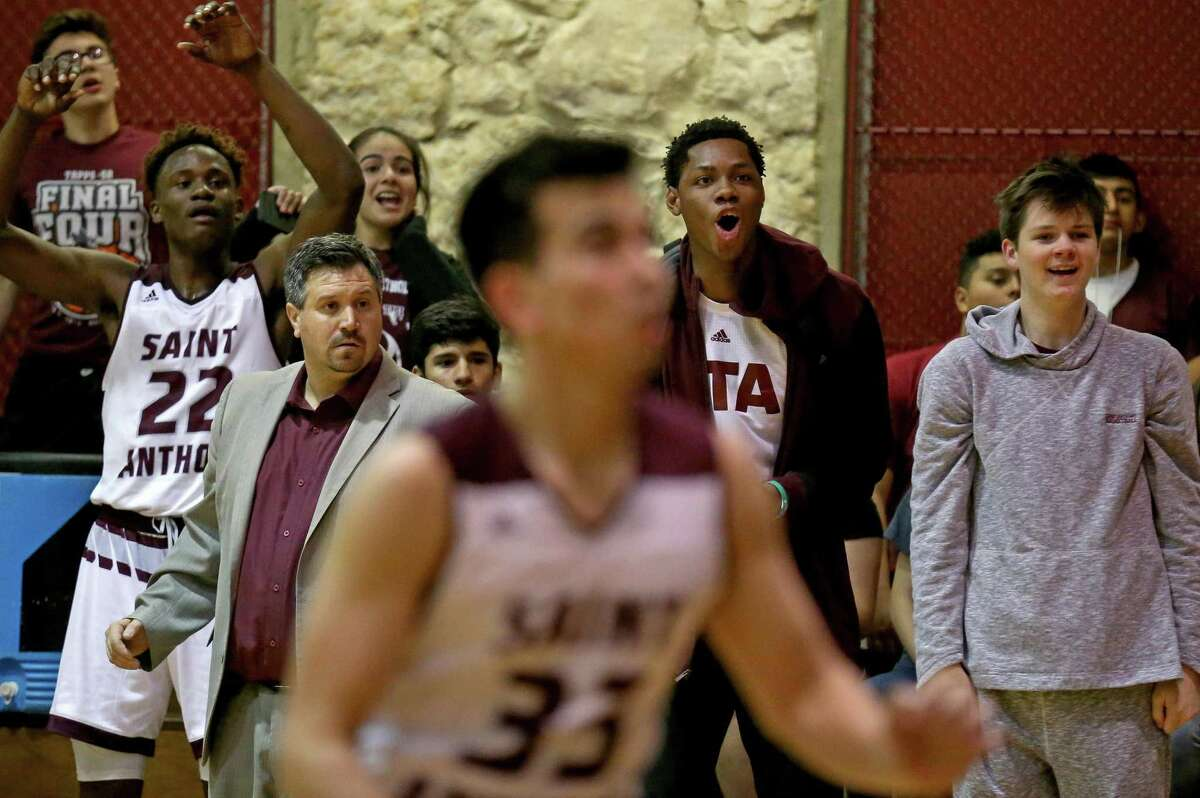 St. Anthony's Obi Prosper (from left), head coach Casey Barksdale, Charles Bassey and Peyton Martin watch action against Texas Christian School on Feb. 25. 2-17/