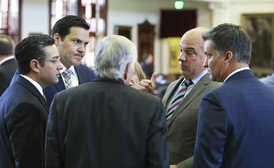 Rep. Chris Turner (second from right) talks with a group of lawmakers on the floor of the House just before the body of Legislators adjourned sine die on August 15, 2017.  From left are Rep. Cesar Blanco, D-El Paso, Rep. Justin Rodriguez, D-San Antonio, Rep. Tom Craddick, R-Midland, Turner, and Rep. Roland Gutierrez, D-San antoni. Photo: San Antonio Express-News / 2017 SAN ANTONIO EXPRESS-NEWS