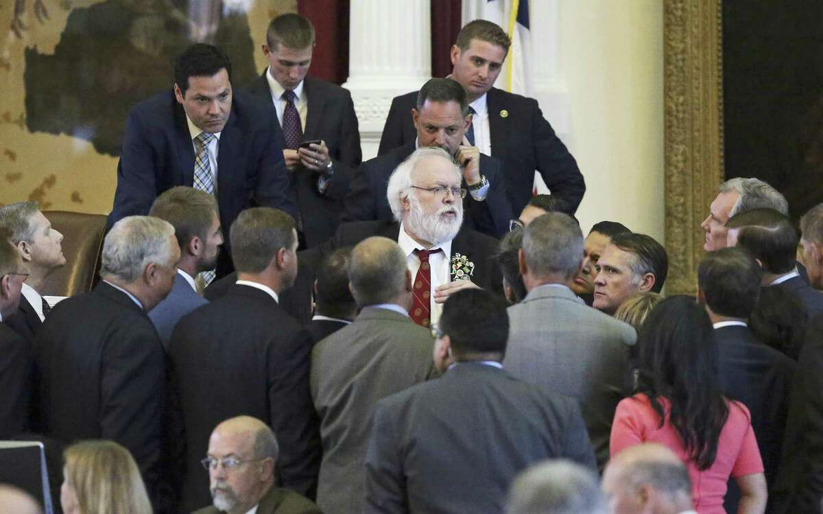 House Parliamentarian Chris Griesel consuls with a group of lawmakers who came to the bench with a point of order started by Rep. Roland Gutierrez who question procedure in the retired teachers beneifts legislation on August 15, 2017.
