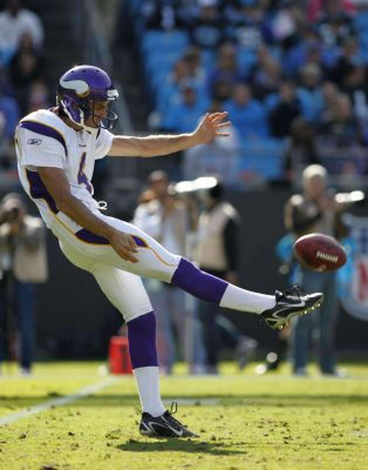 Minnesota Vikings' Chris Kluwe punts to the Carolina Panthers during an NFL football game in Charlotte, N.C.