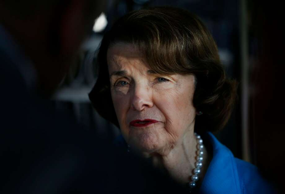 Senator Dianne Feinstein, right, speaks with members of the press on August 10, 2017 in Oakland, Calif. Photo: Leah Millis, The Chronicle