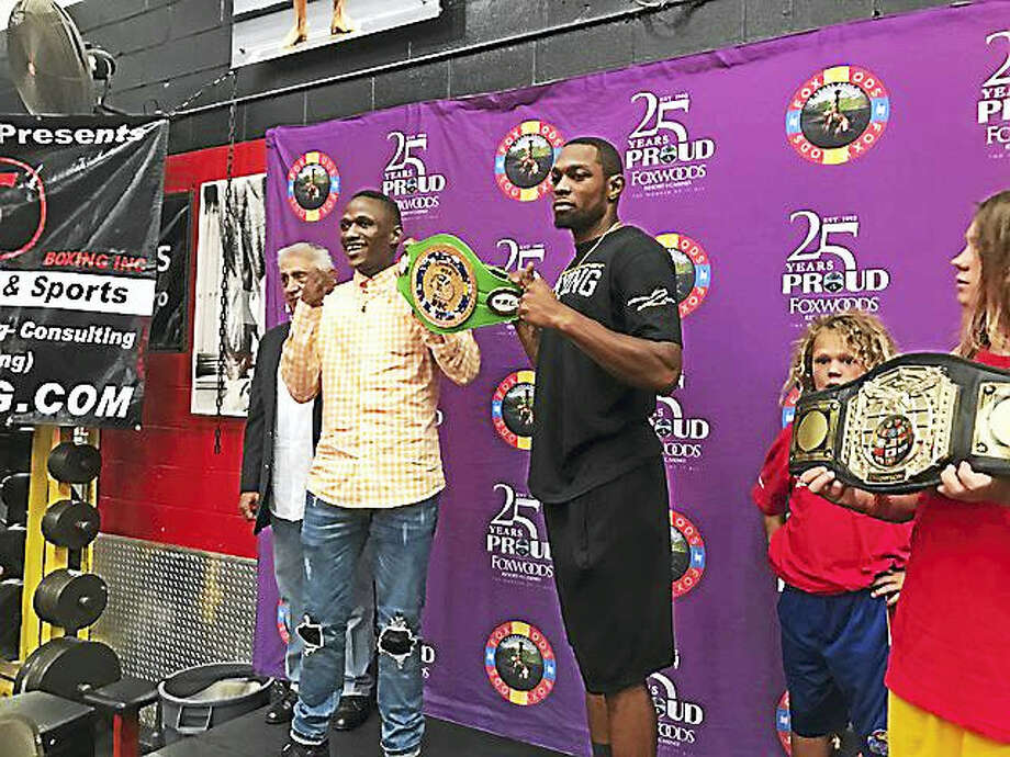 West Haven's Jimmy Williams, right, defended his WBC USNBC welterweight crown on Saturday night with a fourth-round knockout. Photo: Photo By David Borges