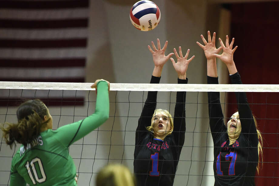Midland Christian's Andie Sheppard (1) and Lauren Danley (17) try to block a hit from Monahans' Taryn Griner (10) Aug. 15, 2017, at McGraw Event Center. James Durbin/Reporter-Telegram Photo: James Durbin