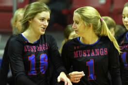 Midland Christian's Shayla Ellison (16) and Andie Sheppard (1) photographed during the game against Monahans Aug. 15, 2017, at McGraw Event Center. James Durbin/Reporter-Telegram