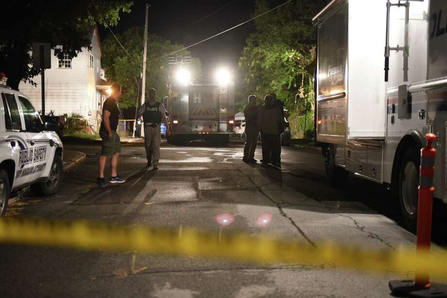 Police investigate the scene on 8th Street and Rensselaer where a man was shot by police in the North Central neighborhood on Tuesday about 6:40 p.m., on Aug. 15, 2017, in Troy, N.Y.  The man was wounded and taken to Albany Medical Center Hospital. (Will Waldron/Times Union) Photo: Will Waldron, Albany Times Union
