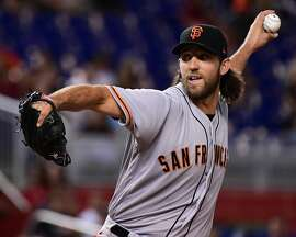 MIAMI, FL - AUGUST 15:  Madison Bumgarner #40 of the San Francisco Giants pitches in the first inning during the game between the Miami Marlins and the San Francisco Giants at Marlins Park on August 15, 2017 in Miami, Florida. (Photo by Mark Brown/Getty Images)