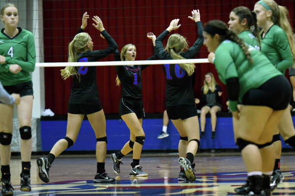 Midland Christian volleyball players celebrate a point against Monahans on Aug. 15, 2017, at McGraw Event Center. James Durbin/Reporter-Telegram