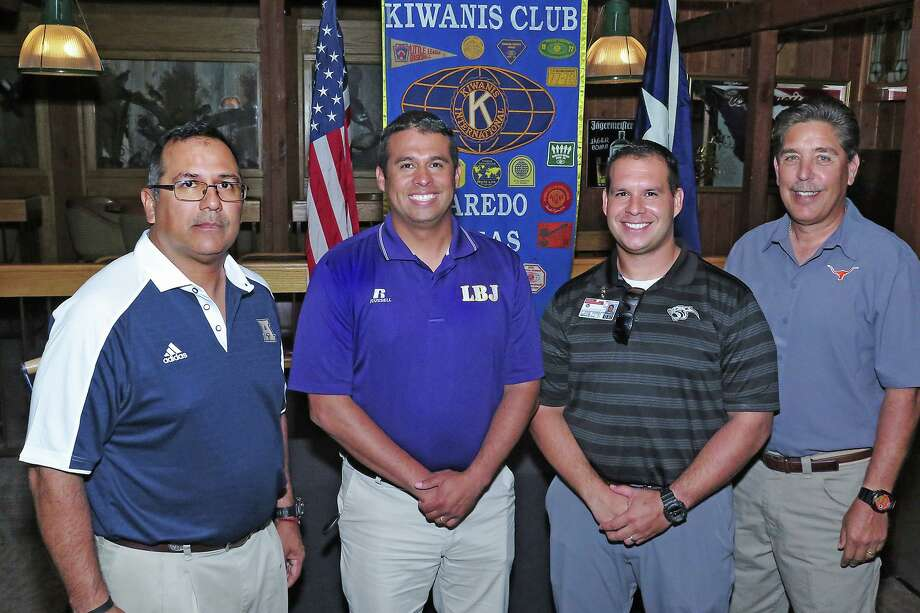 Sergio Salinas, third from left, is taking over as the head coach at Alexander. He was hired following the departure of Joel Lopez, left, who coached the Bulldogs for the past 12 seasons. Photo: Cuate Santos /Laredo Morning Times File / Laredo Morning Times