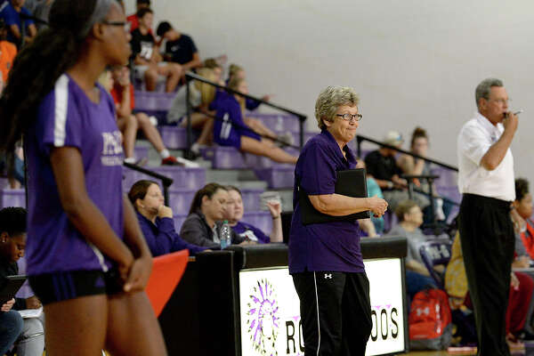 Port Neches - Groves' head coach Barbara Comeaux takes in the action against West Brook during their non-district match-up Tuesday in Port Neches. Photo taken Tuesday, August 15, 2017 Kim Brent/The Enterprise