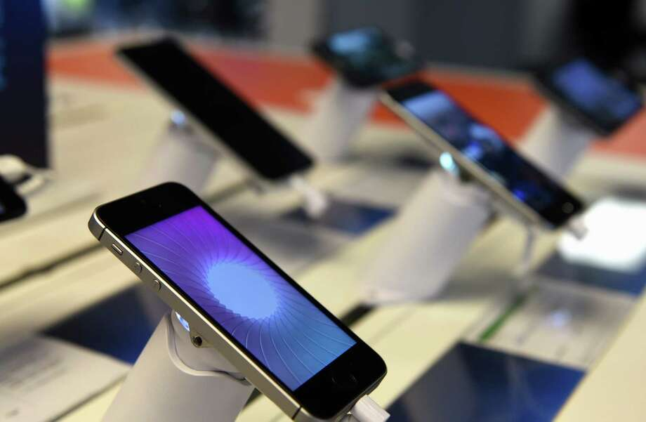 Cellphones are displayed at an AT&T store on Central Avenue on Tuesday, Aug. 15, 2017, in Colonie, N.Y. (Will Waldron/Times Union) Photo: Will Waldron / 20041298A