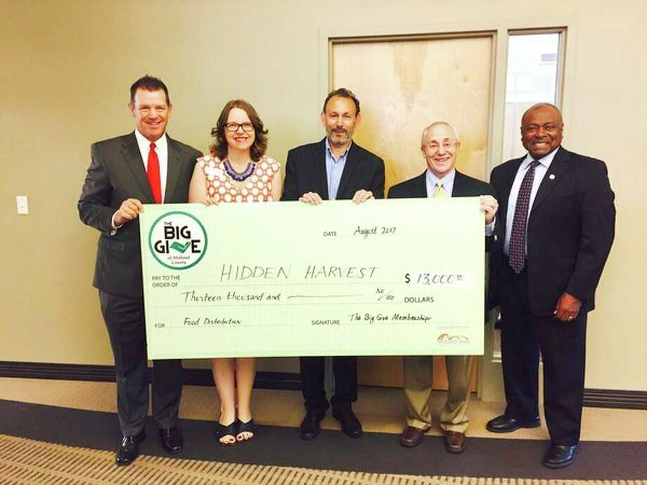 From left, John Wilson, Big Give chair; Samantha McKenzie, Hidden Harvest CEO; Jesse Traschen, Big Give member; Jim Nigro, Big Give member; and Kevin Kendrick, Big Give member pose with a check.