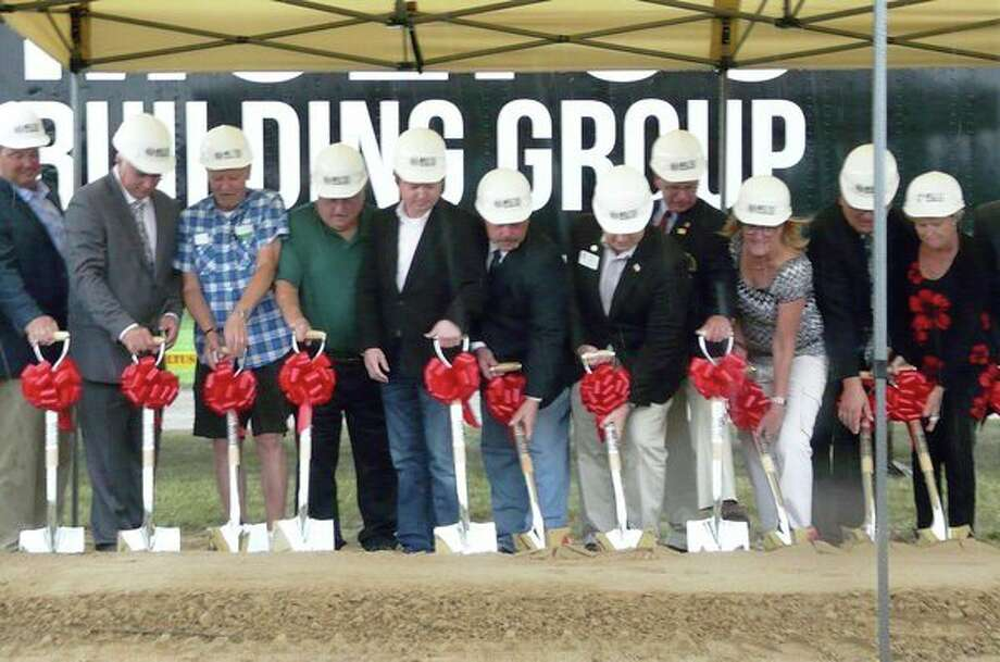 Auburn leaders and other officials participate in a ceremonial groundbreaking on Monday evening to mark the beginning of construction on a $728,500 multipurpose facility at Auburn City Park. (Jon Becker/for the Daily News)