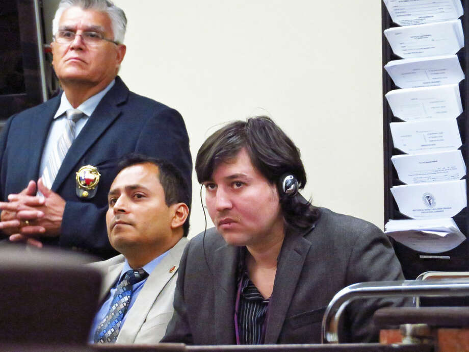 Alberto Espinoza listens to opening statements in his trial in the 111th District Court on Tuesday. Espinoza is accused of murdering his wife at their home in 2014. Photo: Cuate Santos/Laredo Morning Times