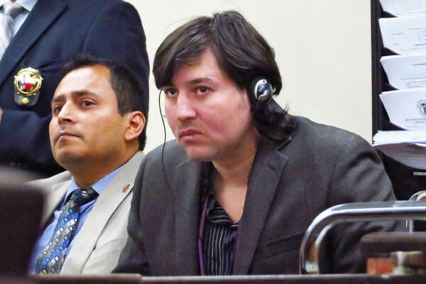Alberto Espinoza listens to opening statements in his trial in the 111th District Court on Tuesday. Espinoza is accused of murdering his wife at their home in 2014.