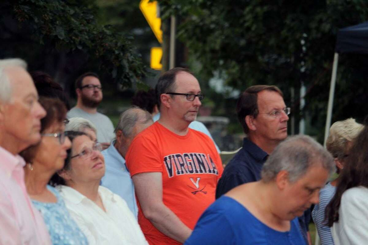 """Joseph Young, of Stamford, wears a University of Virginia shirt at a """"Service of Unity and Community"""" at St. Luke's Parish in Darien, Conn., on Aug. 14 in response to the past weekend's terrorist attacks in Charlottesville, Va."""