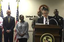 Acting U.S. Attorney Brit Featherston announced Tuesday, Aug. 15, 2017 that 32 people have been charged in federal firearms cases as part of a multi-agency effort to combat gun violence.
