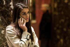 Trump campaign communications director Hope Hicks talks on her phone in the lobby at Trump Tower, December 12, 2016 in New York City. President-elect Donald Trump and his transition team are in the process of filling cabinet and other high level positions for the new administration.