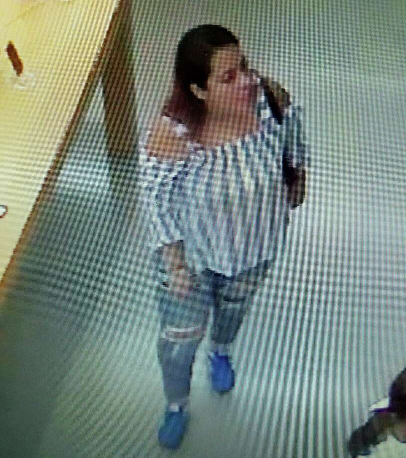 This woman is suspected of stealing a purse from a woman at the TJ Max store in Shelton. The woman's credit card was used to charge nearly $4,200 for merchandise at Apple store at the Westfield Trumbull mall. If anyone recognizes the woman in the photograph they are urged to contact the Shelton Police Department at (203) 924-1544. Photo: Shelton Police Department