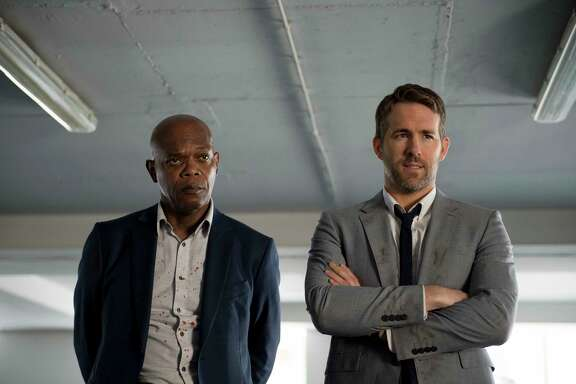 "Samuel L. Jackson, left, and Ryan Reynolds star in ""The Hitman's Bodyguard."""